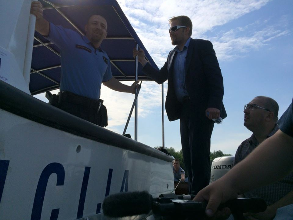 Liberland President Vít Jedlička speaking with a Croatian officer on the Danube River. Croatian officers have arrested Liberland settlers, including Jedlička.
